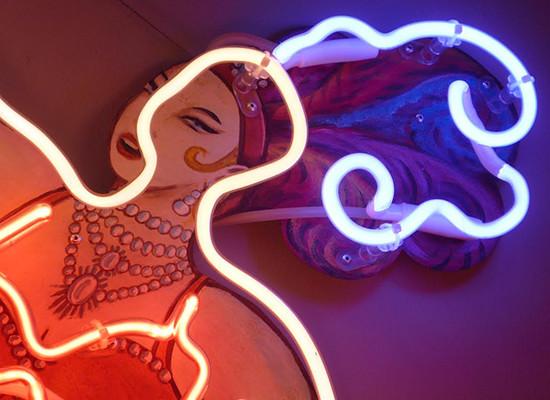 Neon Sign on Print, Extravagant Dancer